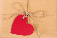 Gift box with heart-shaped labels Royalty Free Stock Photos