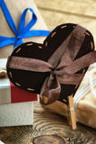 Gift box and heart shapes on a table Stock Photography