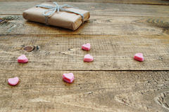 Gift box and heart shapes. On a wooden background Stock Photo