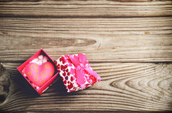 Gift box with a heart on a wooden background. horizontal Stock Images