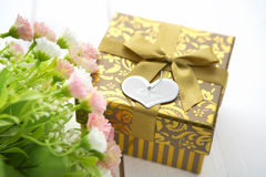 Gift box with heart on wooden table for Valentines day Royalty Free Stock Photography