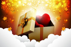Gift box and hearts. In attractive color background Royalty Free Stock Image