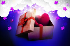 Gift box and hearts. In color background Stock Image