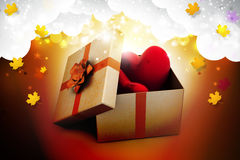 Gift box and hearts. In color background Stock Photo