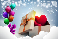 Gift box and hearts. In color background Stock Images