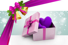 Gift box and hearts. In color background Stock Photography