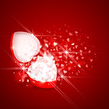 Gift box with hearts. Open gift box with bright rays of light and flying hearts Stock Photo