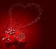 Gift box with Hearts on red background Stock Images