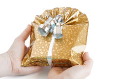 Gift box in her hands Royalty Free Stock Images