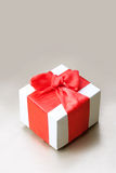 Gift box. Holiday background with gift box and red ribbon. Still life Royalty Free Stock Photography