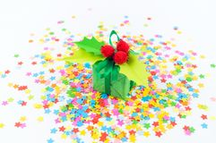 A gift in a box with holly. White background stock photo