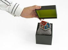 Gift box with house inside Stock Photography