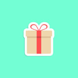 Gift box icon sticker  on green background Royalty Free Stock Images