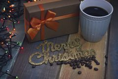 Gift box, inscription Marry Christmas, cup top view Royalty Free Stock Image