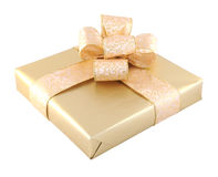 Gift box isolated. Beautifully packed golden gift box isolated on white Royalty Free Stock Photo