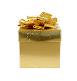 Gift box. Isolated gold-colored gift box on white backgroun stock images