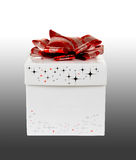 Gift box. Isolated white-colored gift box on gray-gradient background with clipping-path stock image