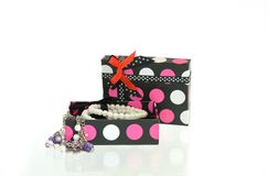 Gift box and jewelry. Open gift box and jewelry Stock Images