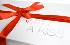 Gift box with a kiss. White gift box with red ribbon, with a kiss Stock Photography