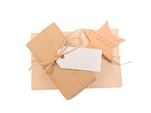 Gift box of kraft paper with tag for text on white background. Gift box of kraft paper with a tag for text on a white background Stock Images