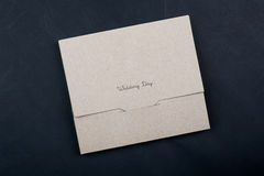Gift box. Kraft paper gift box wedding put on a black background stock photo