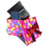 Gift box with a laptop, phone and tablet. 3d illustration.  Stock Photos