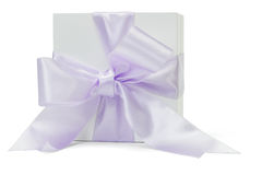 Gift box with large purple ribbon Stock Photos