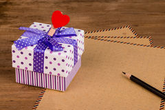 Gift box and letter paper Royalty Free Stock Photo