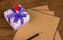 Gift box and letter paper Stock Image