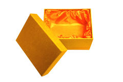 Gift box and lid. Opened pretty golden fabric gift box lined in orange satin with lid Stock Image