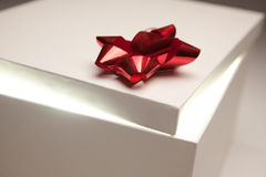Gift Box Lid Showing Very Bright Contents. Gift Box with Red Bow Lid Revealing Very Bright Contents on a Gradated Background Stock Photography