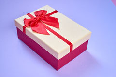 Gift box on light blue background Stock Photography