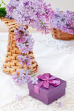 Gift box and lilac bouquet Royalty Free Stock Images