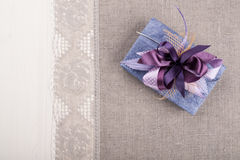 Gift box on linen tablecloth Stock Photo