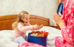 A gift in the box for a little girl. royalty free stock images