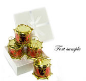 Gift box with little toy drum christmas decoration Stock Image