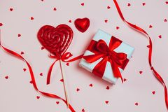 Gift box with lolipop heartshaped on pink background. Romantic st. Valentine`s day concept of greetings. place for your text. Top. View, flat lay Royalty Free Stock Photos