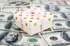 Gift box and lots of dollars. royalty free stock photo
