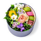 Gift box with macaroons and flowers Stock Photos