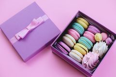Gift box with macaroons and marshmallows. royalty free stock photos