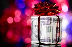 Gift box made of dollars Royalty Free Stock Image