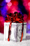 Gift box made of dollars Stock Images