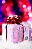 Gift box made of dollars Stock Photos
