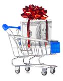 Gift box made of dollars in shopping cart. Cut out from white Royalty Free Stock Photos