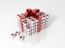 Gift box made of little gift boxes. With a red ribbon on a white reflective background Royalty Free Stock Photos