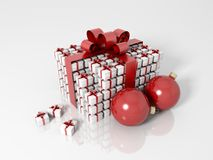 Gift box made of a lot of little gift boxes. With christmas balls and a red ribbon on a white reflective floor Stock Photo