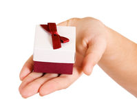 Gift box in man's hand with red ribbon Royalty Free Stock Photos
