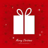 Gift box with Merry Christmas text on red background Royalty Free Stock Image