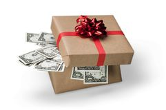 Gift box with money on white background. Money gift box us dollar dollar bills background colorful Stock Photography