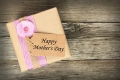Gift box with Mother's Day tag on wood Stock Image